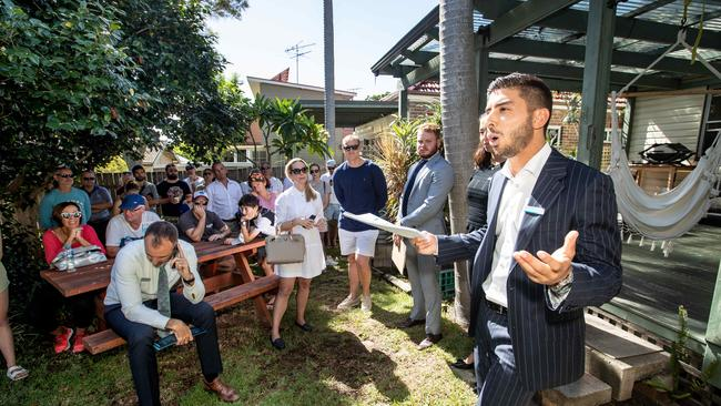 Some homes have continued to get strong results at auction. Auctioneer Matt Nicastri dropped the hammer on this Freshwater house at $1.86 million. Picture: AAP/Julian Andrews