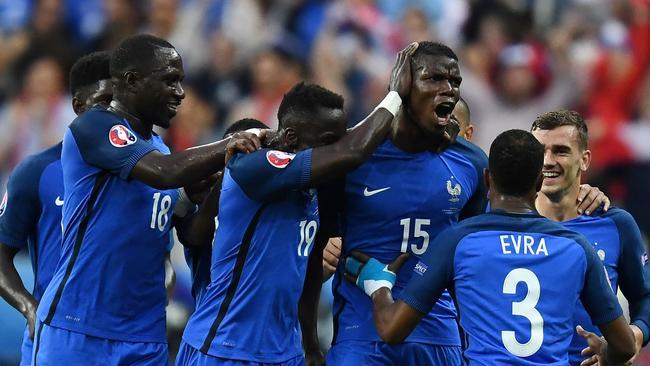 France teammates celebrate with scorer France's midfielder Paul Pogba.