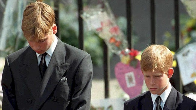 Prince William and Prince Harry bow their heads as their mother's Princess Diana's coffin is taken out of Westminster Abbey following her funeral service. Picture: AFP PHOTO / POOL / Adam BUTLER