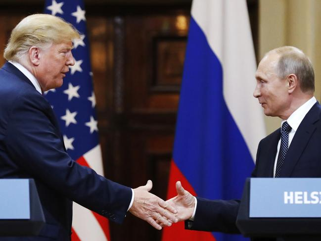 U.S. President Donald Trump shakes hands with Russian President Vladimir Putin at the end of the press conference after their meeting at the Presidential Palace in Helsinki, Finland. Picture: AP