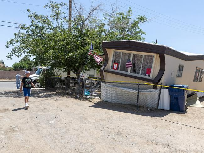 A child walks by one of the mobile homes knocked off its foundation by an earthquake in Ridgecrest on Friday. Picture: AP