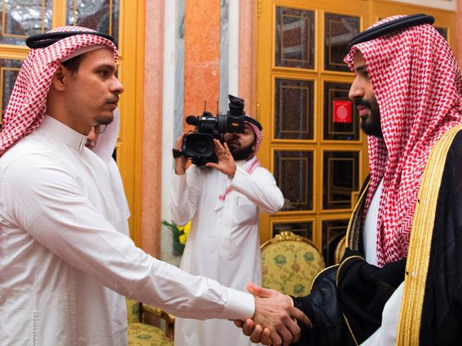 Saudi Crown Prince Mohammed bin Salman with Jamal Khashoggi's son, Salah. The CIA reportedly has evidence the crown prince knew about the killing. Picture: AP