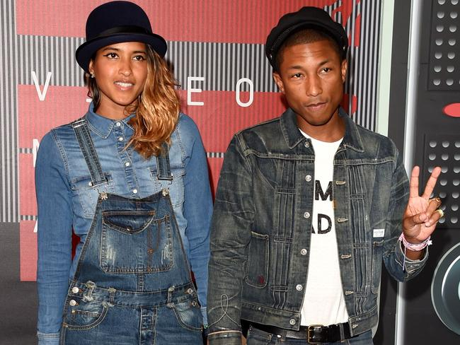 Cute couple alert! ... Helen Lasichanh and recording artist Pharrell Williams. Picture: Getty