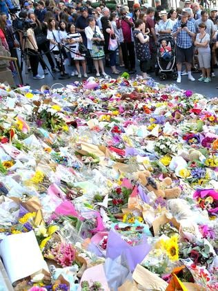 Floral tributes for victims of the Bourke Street Mall attack. Picture: Ian Currie