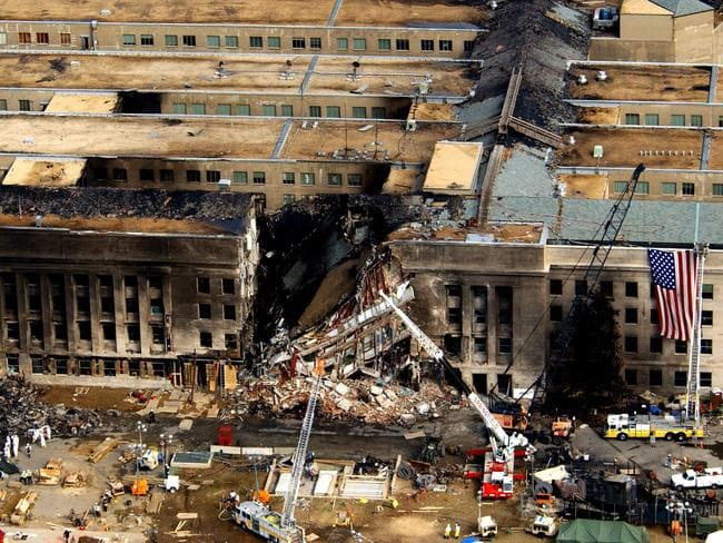 FBI agents, firefighters, rescue workers and engineers work at the Pentagon crash site on September 14, 2001, where a hijacked American Airlines flight slammed into the building on September 11. The terrorist attack caused extensive damage to the west face of the building and followed similar attacks on the twin towers of the World Trade Centre in New York City. Picture: Department of Defence/ Tech Sgt Cedric H. Rudisill