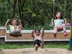 Children play on swings at a nursery for workers at Chonsam Cooperative Farm on August 22, 2018 in Wonsan, North Korea. Picture: Carl Court/Getty Images