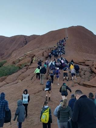 Tourists have flocked to Uluru in Australia's Northern Territory to climb the landmark before the ban. Picture: @koki_mel_aus. / AFP