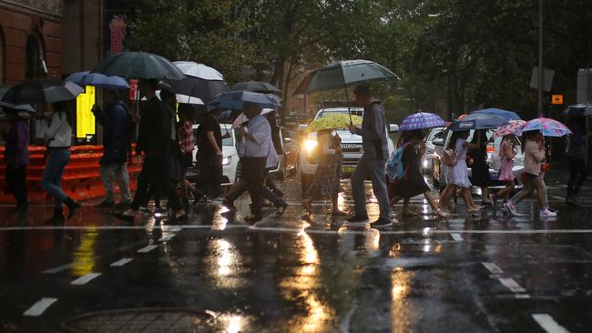 Pedestrians battled the wet on March 17. Picture: AAP Image/Steven Saphore