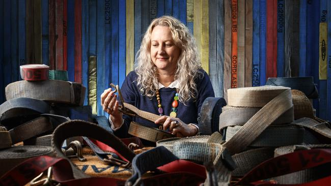 The Advertiser Contemporary Art Award finalist Jane Skeer with some of the recycled truck ratchet straps she uses to create her works. Picture: MATT TURNER
