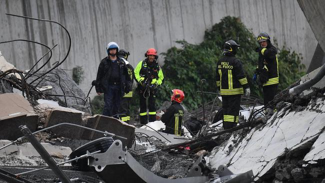 Rescues work among the debris of the collapsed Morandi Bridge in Genoa.