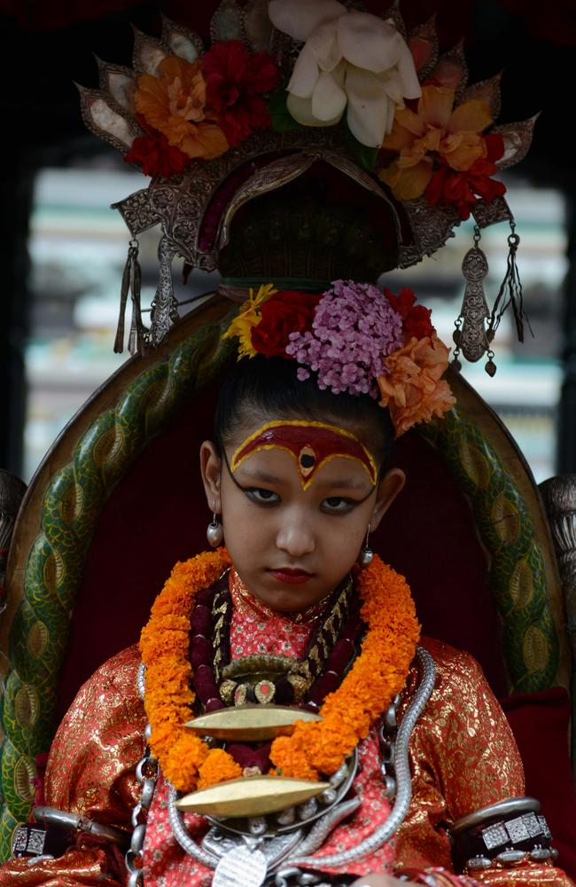 Yunika is a Kumari, who is believed to bring good luck to anyone who views her. Picture: AFP/Prakash Mathema.