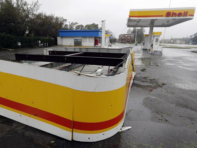 The shelter of a petrol station lies on the ground in Wilmington, North Carolina, after Hurricane Florence made landfall Friday, September 14, 2018. Picture: AP/Chuck Burton