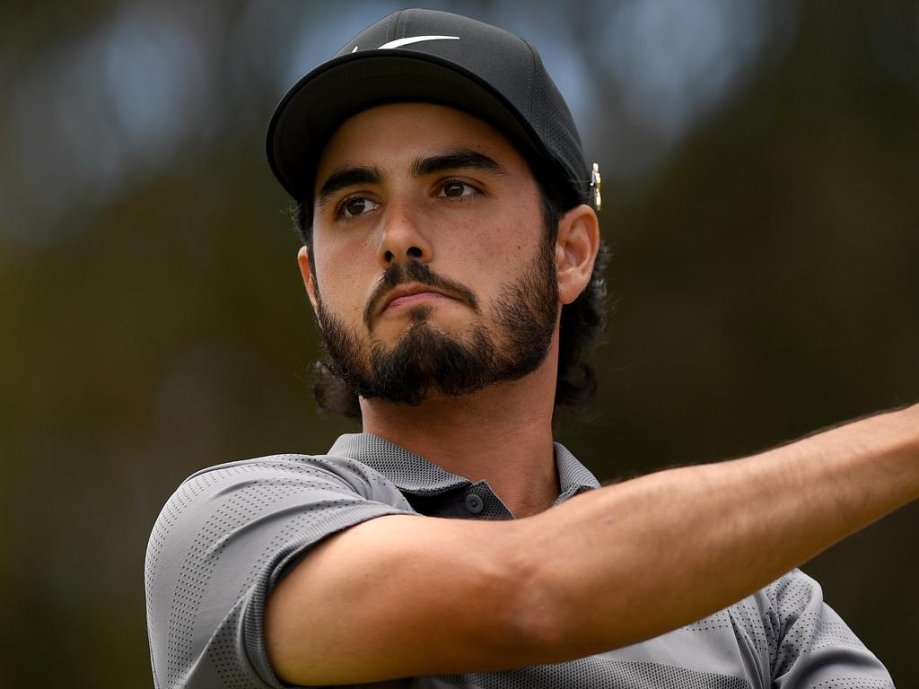 Abraham Ancer of Mexico watches his shot from the 2nd tee during round 4 of the Australian Open Golf Tournament at The Lakes Golf Club in Sydney, Sunday, November 18, 2018. (AAP Image/Dan Himbrechts) NO ARCHIVING, EDITORIAL USE ONLY