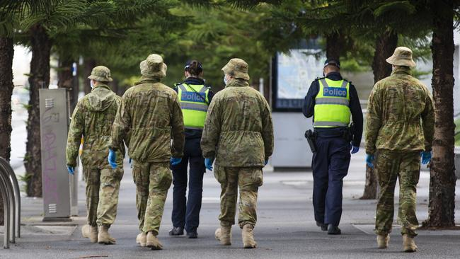 Police and ADF patrol around Docklands. Picture: NCA NewsWire / Sarah Matray