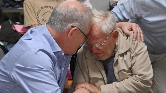 Scott Morrison comforts 85-year-old Owen Whalan at an evacuation centre in Taree. Picture: Peter Parks/AFP
