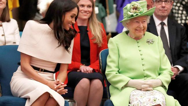 Britain's Queen Elizabeth II and Meghan, Duchess of Sussex gesture during their visit to the Storyhouse in Chester. Picture: AFP