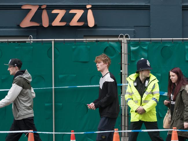 Police stand guard outside the Zizzi restaurant in Salisbury.