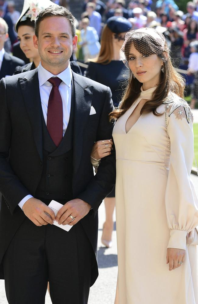 Patrick J. Adams and wife Troian Bellisario arrive at the royal wedding. Picture: AP
