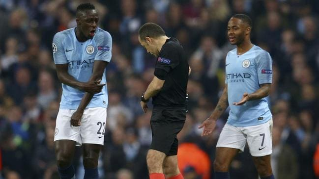 City players complain to the referee after the late VAR drama.