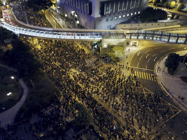 Pro-democracy protesters march into the night. Picture: AP