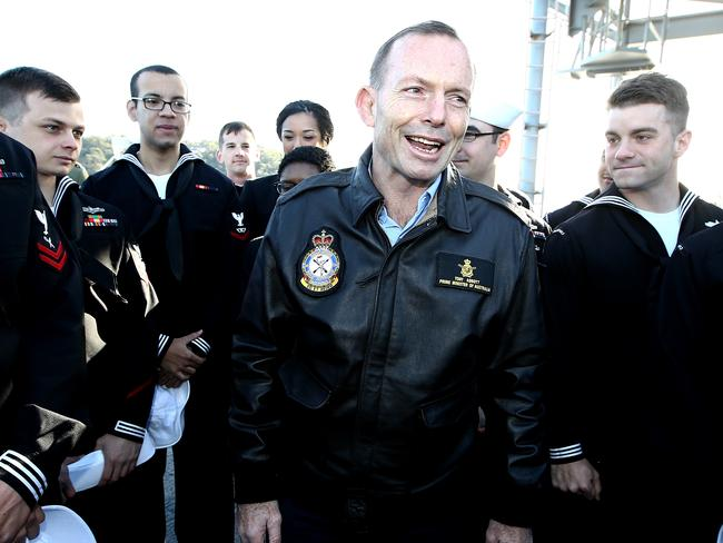Inspecting the troops ... Mr Abbott speaking with sailors taking part in the Talisman Sabre Operation. Picture: Tim Hunter.