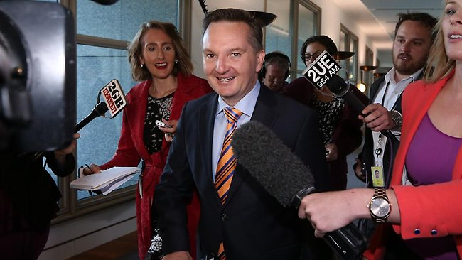 Former Minister for Tertiary Education, Skills, Science and Research, Chris Bowen is chased by the media yesterday.