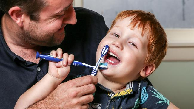 Three-year-old Jack Ryan brushes his teeth with dad Dan. Picture: Tim Carrafa
