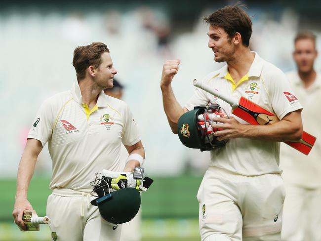 Steve Smith (L) and Mitchell Marsh walk off after the drawn MCG Test.