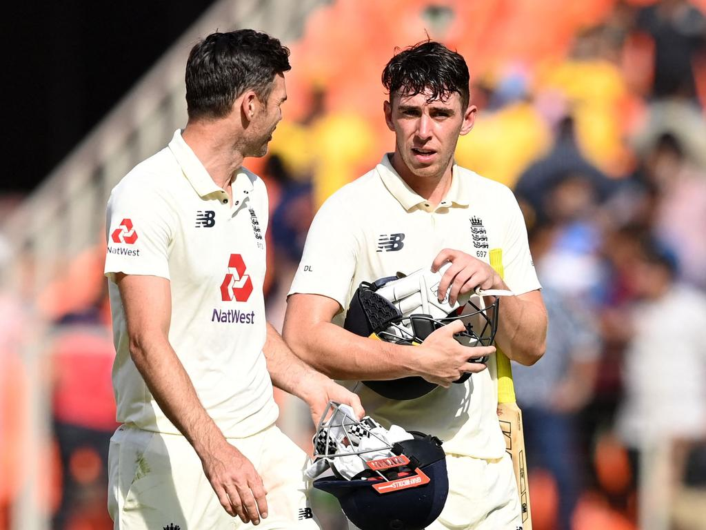 England's James Anderson (L) and teammate Dan Lawrence walk back to the pavilion after they lost on the third day of the fourth Test cricket match between India and England at the Narendra Modi Stadium in Motera on March 6, 2021. (Photo by Sajjad HUSSAIN / AFP) / IMAGE RESTRICTED TO EDITORIAL USE - STRICTLY NO COMMERCIAL USE