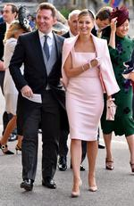 Nick Candy and Holly Candy arrive ahead of the wedding of Princess Eugenie of York to Jack Brooksbank at Windsor Castle on October 12, 2018 in Windsor, England. (Photo by Matt Crossick - WPA Pool/Getty Images)