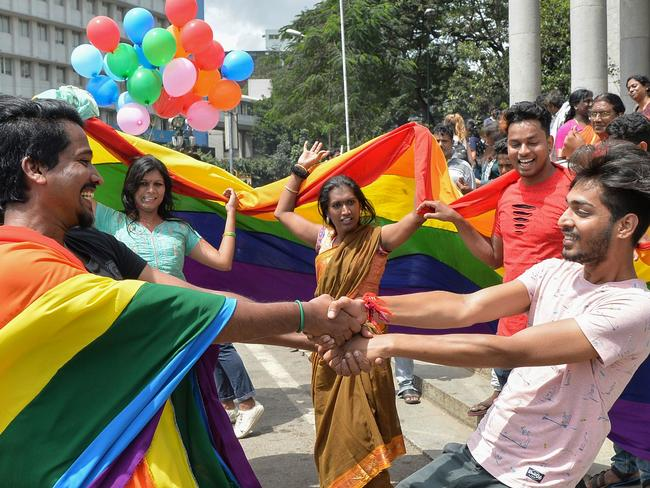 Indian members and supporters of LGBT community celebrate the Supreme Court decision. Picture: Manjunath Kiran/AFP