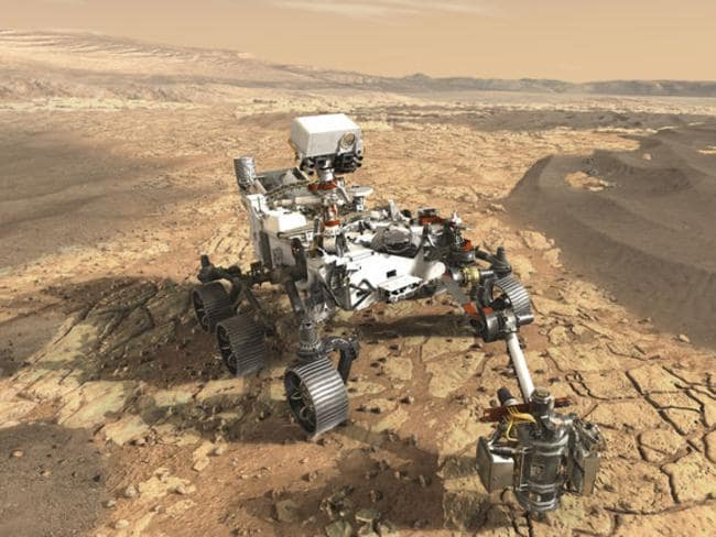An artist's concept of the Mars 2020 Rover exploring a dried up waterbed for signs of life. Picture: NASA