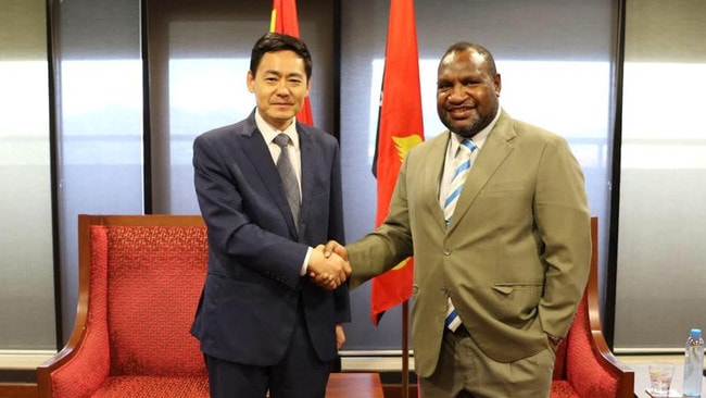 Papua New Guinea Prime Minister James Marape with Chinese Ambassador to PNG Xue Bing in August.