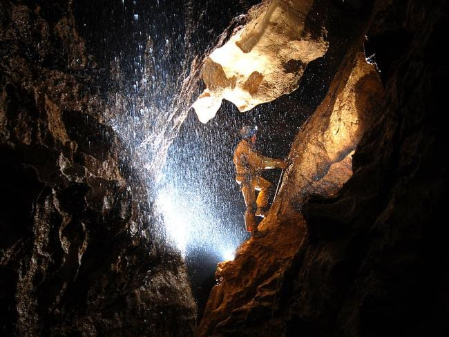 'Massive thing' ... a spelunker explores the cave, which is over 20km long and up to 1148 meters deep.