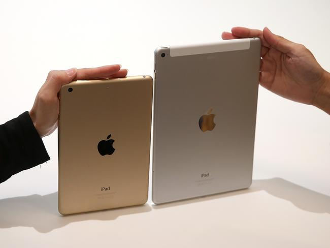 Hands on ... The new iPad Air 2 (R) and iPad Mini 3 were unveiled overnight during an Apple special event in Cupertino, California. Pic: Justin Sullivan/Getty Images/AFP