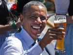 US President Barack Obama holds a glass of beer at a breakfast meeting with the German chancellor and local citizens in Kruen near Garmisch-Partenkirchen, southern Germany, on June 7, 2015. Picture: AFP PHOTO / DANIEL KARMANN