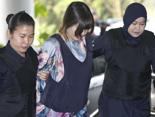 Vietnamese Doan Thi Huong is escorted by police as she arrives for a court hearing. Picture: AP