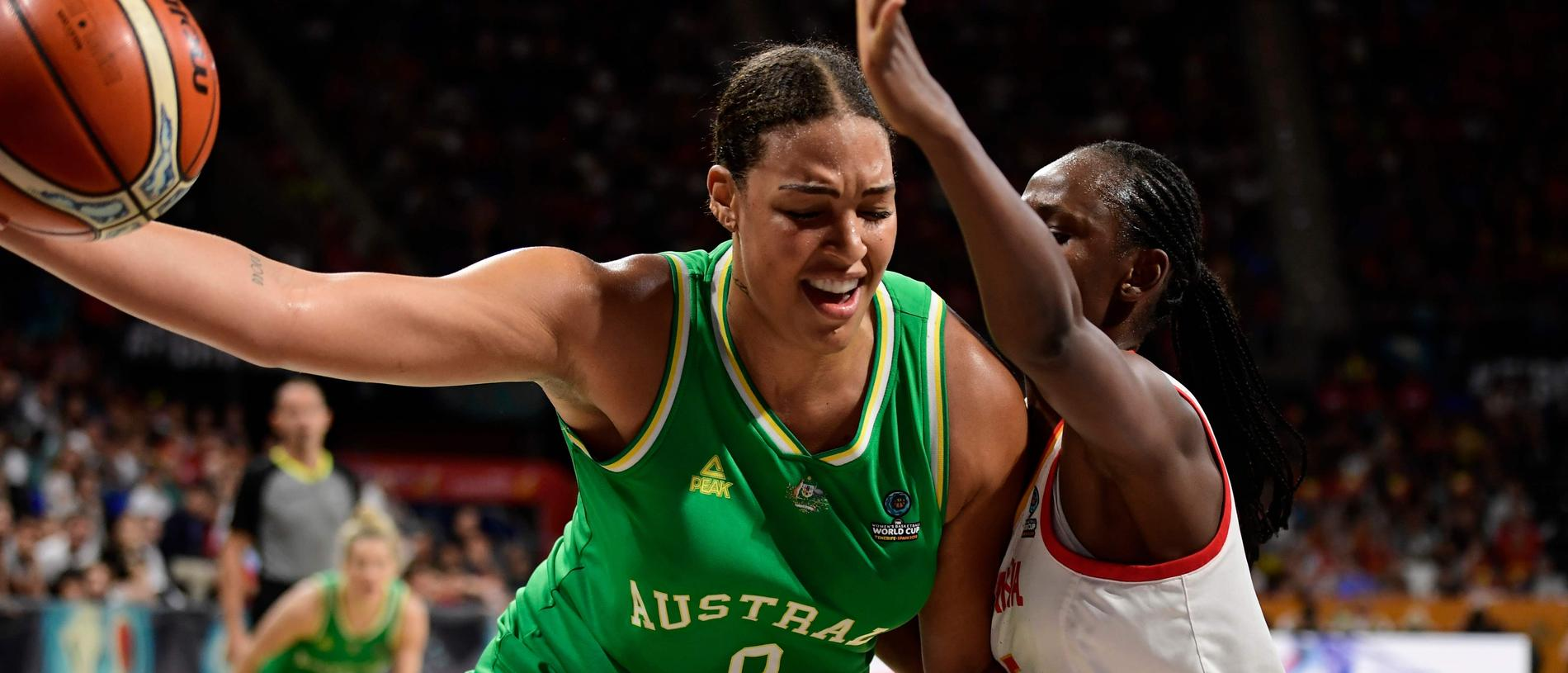 Australia's center Liz Cambage (L) vies with Spain's forward Astou Ndour during the FIBA 2018 Women's Basketball World Cup semifinal match between Spain and Australia at the Santiago Martin arena in San Cristobal de la Laguna on the Canary island of Tenerife on September 29, 2018. (Photo by JAVIER SORIANO / AFP)
