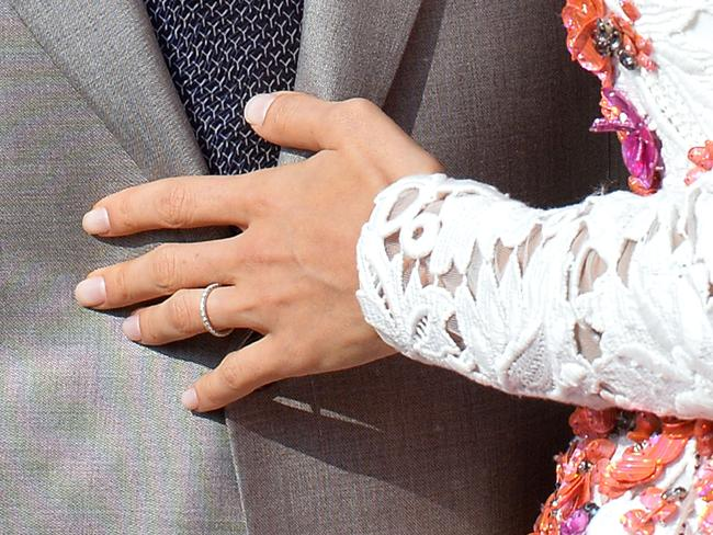 Close up ... the wedding band of Amal Alamuddin as she stands next to her husband George Clooney aboard a taxi boat on the Grand Canal. Picture: AFP