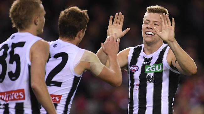Jordan De Goey celebrates one of his six goals against St Kilda.