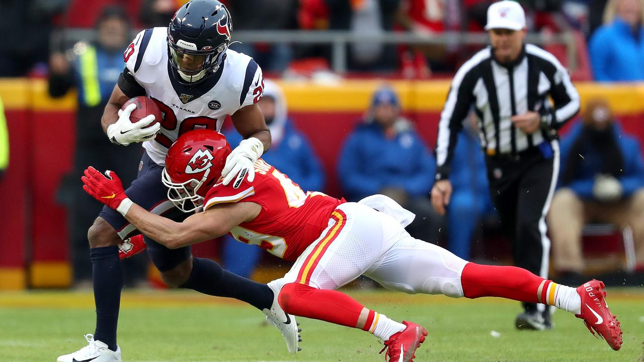 Justin Reid of the Houston Texans is tackled by Daniel Sorensen of the Kansas City Chiefs on a fake punt attempt.