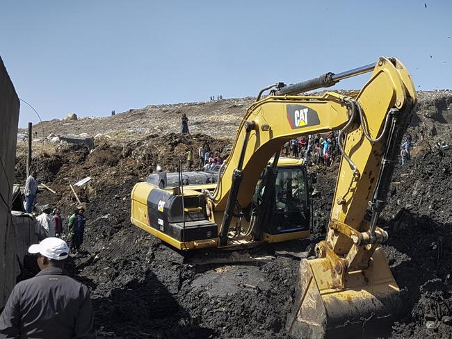 Rescuers use an excavator in their hunt for survivors. Picture: AP Photo/Elias Meseret