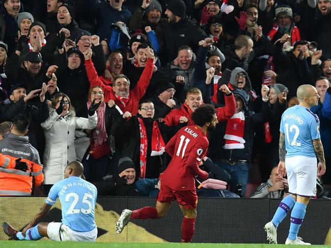 Mohamed Salah celebrates. (Photo by Paul ELLIS / AFP)