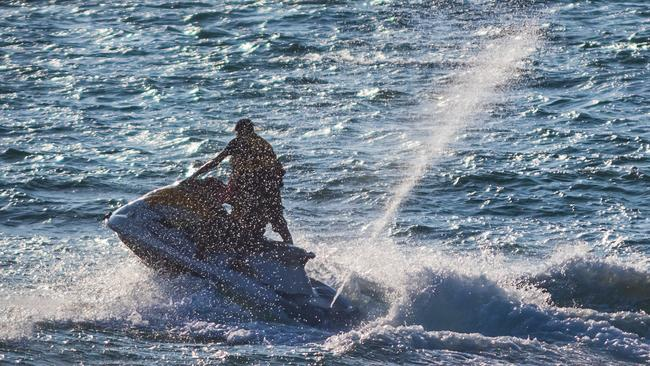 The woman was flung from the seat of the jetski and landed on the handle bars.