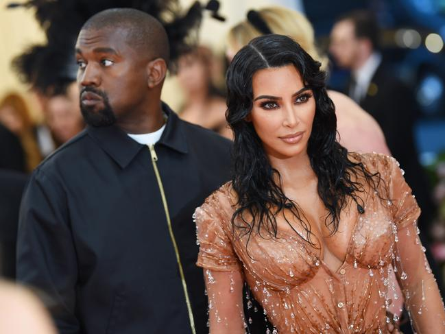 Kanye looks like he'd rather be anywhere else. Picture: Dimitrios Kambouris/Getty Images for The Met Museum/Vogue