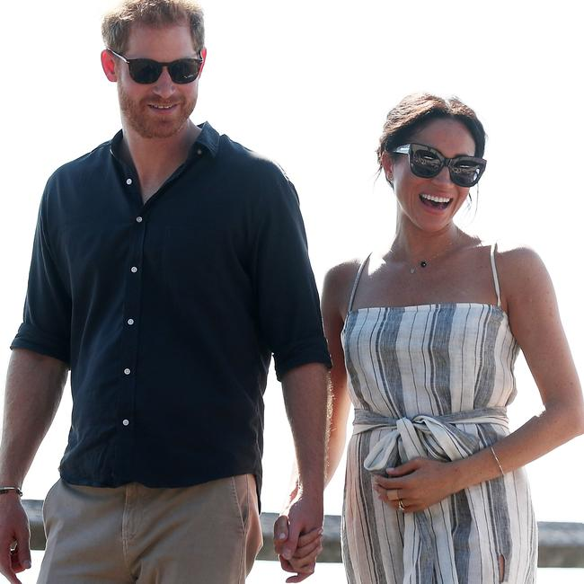 Prince Harry, Duke of Sussex and Meghan, Duchess of Sussex hand-in-hand during their Aussie royal tour in Fraser Island.