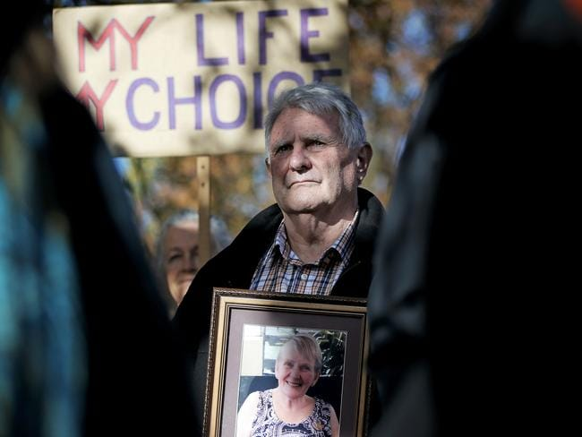 Andrew Irving, holding a photo of wife Marilyn, who passed away after a long illness, at a rally supporting a voluntary assisted dying bill. Picture: Luke Bowden