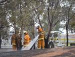 Angle Vale bushfire which burnt in a South East direction towards Munno Para Downs. CFS members from Sheoak Log mop up. Picture: Naomi Jellicoe