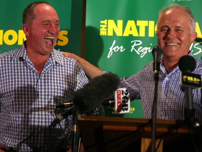 Prime Minister Malcolm Turnbull joins Barnaby Joyce, celebrates on stage his win in the New England by-election. Picture: Lyndon Mechielsen