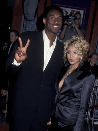 """Kobe and wife Vanessa attend the premiere of """"Rush Hour 2"""" on July 26, 2001 at Mann Chinese Theater in Hollywood, California. (Photo by Ron Galella, Ltd./Ron Galella Collection via Getty Images)"""